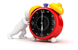 Person pushes alarm clock Royalty Free Stock Photography