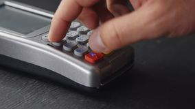Person pushing the button and swipe credit card payment on pos terminal stock video footage