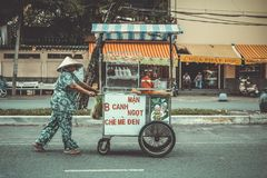 Person Pushing Food Cart On Road stock photo