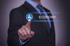 Person pushing hologram of economy icon Stock Photography