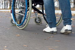 Person pushing a wheelchair Stock Photography