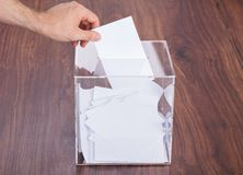 Person putting ballot in box Royalty Free Stock Photo