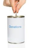 Person Putting Coin In Donation puede Fotografía de archivo libre de regalías