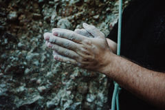 Person Putting Hands Together Covered in Gray Dust Royalty Free Stock Image