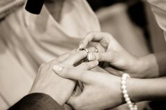 Person Putting Ring on Another Person in Grayscale Photography Royalty Free Stock Photo