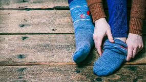 Person putting on socks Royalty Free Stock Image