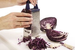 Person rasping red cabbage Stock Images
