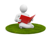 Person read book sitting on grass Royalty Free Stock Photo