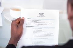 Person reading resume Royalty Free Stock Image