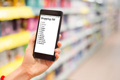 Person reading shopping list on smartphone Royalty Free Stock Photos