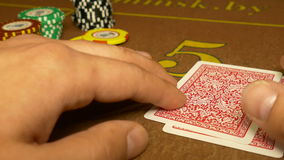 The person receives and checks his cards. Checks his cards two aces stock footage