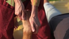 Person receiving hand massage outdoors. stock footage