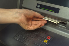Person receiving money from the ATM. Selective focus Royalty Free Stock Image