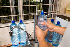 Person recycle empty plastic bottle from filtered tap water Stock Photo