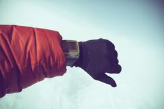 Person in Red Jacket and Black Gloves Wearing Gray Digital Watch Royalty Free Stock Photography