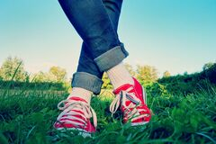 Person in Red Low Top Sneakers Stock Images