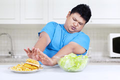 Person refuse to eat fast food Royalty Free Stock Images