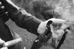 Person Releasing Shotgun Shell on Shotgun Stock Images