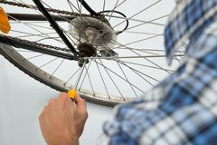 Person Repairing Bicycle Wheel Stock Image