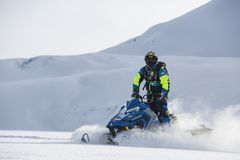 Person Rides on Blue Snowmobile at Daytime Stock Photo