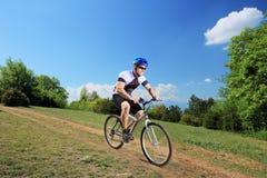 Person riding a bicycle. In a non-urban area Stock Photo