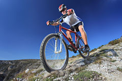 Person riding a bike. Downhill style Stock Photos