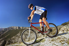 Person riding a bike. Downhill style Stock Image