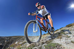Person riding a bike. Downhill style Stock Photography