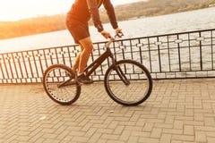 Person riding a bike on esplanade Royalty Free Stock Photos