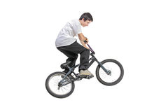 Person riding a bike in jump. Isolated against white background Stock Photo