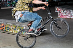 Person Riding BMX Flatland Freestyle At Skate Park Royalty Free Stock Image