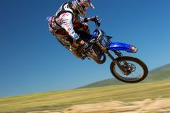 Person Riding Dirt Bike in the Air Royalty Free Stock Photos