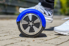 Person riding a  hover board scooter Royalty Free Stock Photo