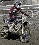 Person Riding on Motorcycle on Motocross Race Track Wearing White and Black Oakley Full Face Helmet during Daytime Stock Image