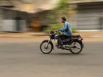 Person Riding Motorcycle On Road. Blurred Motion Of Person Riding Motorcycle On Road Stock Photos