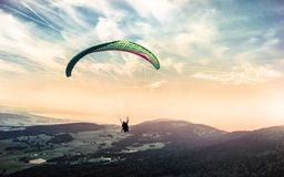 Person Riding Paragliding Under Blue and White Cloudy Sky Royalty Free Stock Photography
