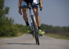Person Riding Road Bike on the Road Royalty Free Stock Photos