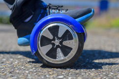 Person riding a Segway hover board scooter Royalty Free Stock Photos
