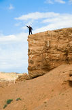 Person on a rock. Man on a rock with the lifted hand Stock Images
