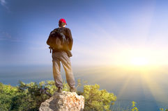 The person on a rock looks  at ocean Royalty Free Stock Photos