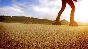 A person in roller-skates goes by the running track stock video footage