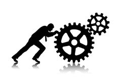 Person rotates gear wheels Royalty Free Stock Photos