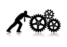 Person rotates gear wheels Stock Images