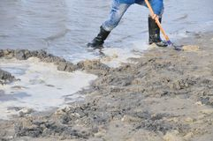 Person in rubber boots on beach Stock Photo