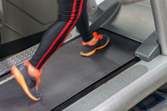 A person is running hard on a treadmill Royalty Free Stock Photos