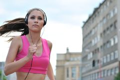 Person running and listening music Royalty Free Stock Photos
