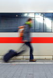 Person Rushing For Train. Travel Image Of A Motion Blurred Student Rushing To Catch A Train Stock Image