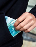Person with Russian Currency. Person hold the Russian Currency in the Pocket on the Street closeup Royalty Free Stock Photos