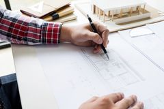 Person& x27;s engineer Hand Drawing Plan On Blue Print or working pro. Ject in his office with architect equipment Royalty Free Stock Photography