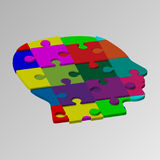 A person`s face consists of a multi-colored puzzle. illustration of a logical task Stock Image